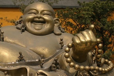 Laughing Buddha (image source - Buddha Collective)