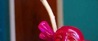 Small Laughing Buddha with flower (image via Buddha Collective)